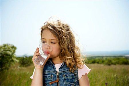 Girl drinking water Stock Photo - Premium Royalty-Free, Code: 649-02198884