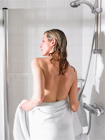 Woman in shower Stock Photo - Premium Royalty-Free, Code: 649-02199004