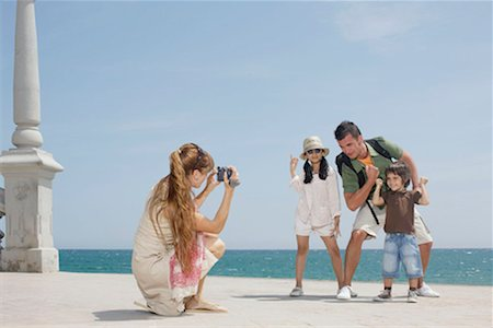 Mother taking video of family by sea Stock Photo - Premium Royalty-Free, Code: 649-02199254