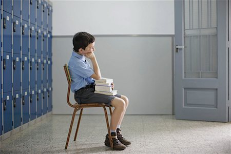 School boy sitting with books Stock Photo - Premium Royalty-Free, Code: 649-02199305