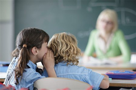 School girl whispering Stock Photo - Premium Royalty-Free, Code: 649-02199314
