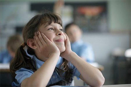 School girl daydreaming in class Stock Photo - Premium Royalty-Free, Code: 649-02199320