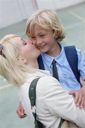 preteen kissing - Mother kissing school boy Stock Photo - Premium Royalty-Free, Code: 649-02199359