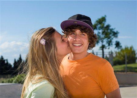 Teen girl kissing teen boy Stock Photo - Premium Royalty-Free, Code: 649-02290305