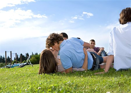 Teen lovers kissing in front of friends Stock Photo - Premium Royalty-Free, Code: 649-02290314