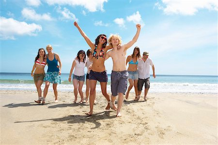 Group having a race on the beach Stock Photo - Premium Royalty-Free, Code: 649-02290451