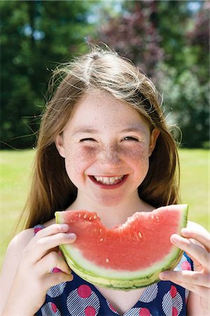 Girl eating a watermelon Stock Photo - Premium Royalty-Free, Code: 649-02424064