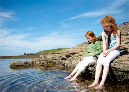 preteen girl feet - 2 girls putting feet in rock pool Stock Photo - Premium Royalty-Free, Code: 649-02423980