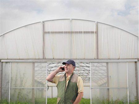 farm phone - Farmer On Mobile Outside Polytunnel Stock Photo - Premium Royalty-Free, Code: 649-02666551