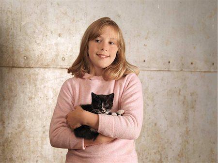 preteen girl pussy - Girl Holding Kitten Stock Photo - Premium Royalty-Free, Code: 649-02666647