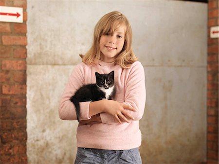 preteen girl pussy - Girl Holding Kitten Stock Photo - Premium Royalty-Free, Code: 649-02666648