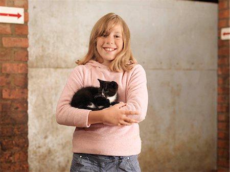 preteen girl pussy - Girl Holding Kitten Stock Photo - Premium Royalty-Free, Code: 649-02666649