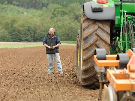 plow - Farmer Examining Soil In Field Stock Photo - Premium Royalty-Free, Code: 649-02666683