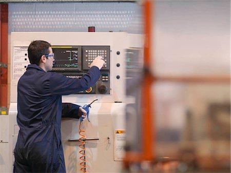 Engineer With Machine Stock Photo - Premium Royalty-Free, Code: 649-02666783