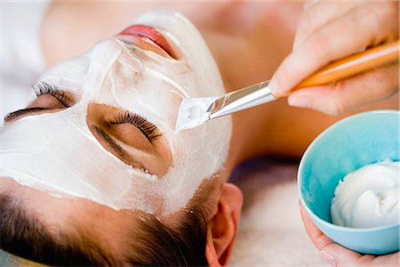 facial - Woman is getting a face mask Stock Photo - Premium Royalty-Free, Code: 649-02731249