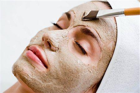 facial - Woman getting face mask Stock Photo - Premium Royalty-Free, Code: 649-02731257