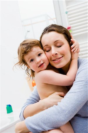Mother hugging her baby Stock Photo - Premium Royalty-Free, Code: 649-02731329