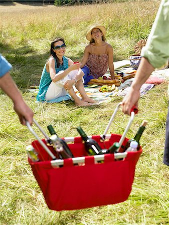 Friends having a picnic in a field Stock Photo - Premium Royalty-Free, Code: 649-02731744