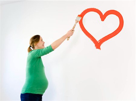 Pregnant woman painting nursery Stock Photo - Premium Royalty-Free, Code: 649-02732234