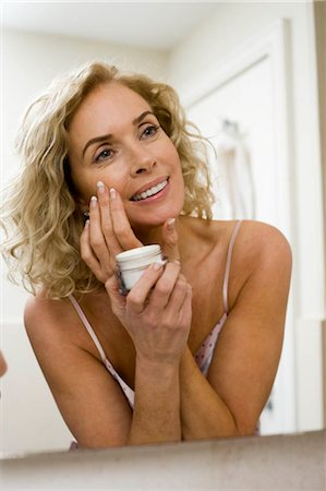 Woman with face cream Stock Photo - Premium Royalty-Free, Code: 649-02732374