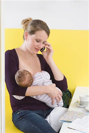 Mother breastfeeding baby,  on the phone Stock Photo - Premium Royalty-Free, Code: 649-02732531