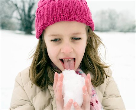 preteen girl licking - Girl tasting snow ball Stock Photo - Premium Royalty-Free, Code: 649-02732789