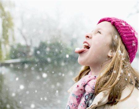 preteen girl licking - Girl in snowfall Stock Photo - Premium Royalty-Free, Code: 649-02732790