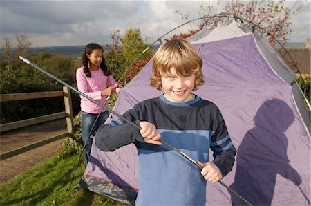 Boy and girl putting up tent Stock Photo - Premium Royalty-Free, Code: 649-02733239