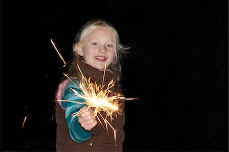 Young girl with sparkler Stock Photo - Premium Royalty-Free, Code: 649-02733307