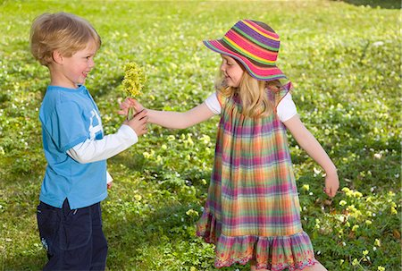 girl giving spring flower bouquet to boy Stock Photo - Premium Royalty-Free, Code: 649-03009348