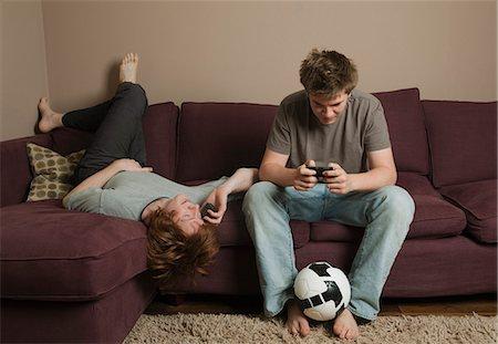 Boys using mobile phones Stock Photo - Premium Royalty-Free, Code: 649-03077861