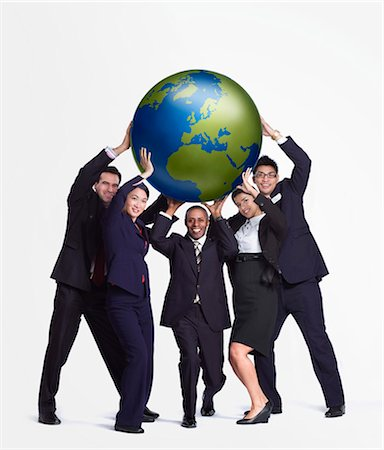 A business group holding up a big globe Stock Photo - Premium Royalty-Free, Code: 649-03077993