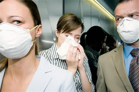 People in a lift during a health alert Stock Photo - Premium Royalty-Free, Code: 649-03078665