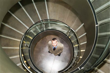 dynamic - Business man at bottom of spiral stairs Stock Photo - Premium Royalty-Free, Code: 649-03078660