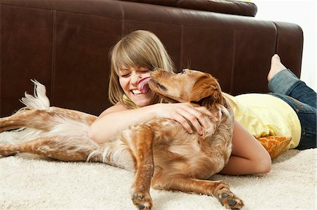dog lick - Pet dog licking a young woman's face Stock Photo - Premium Royalty-Free, Code: 649-03154251