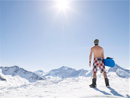 sports and snowboarding - topless man with snowboard Stock Photo - Premium Royalty-Free, Code: 649-03154675