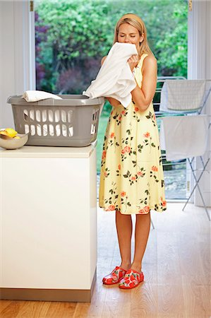 Beautiful young housewife doing laundry Stock Photo - Premium Royalty-Free, Code: 649-03154894