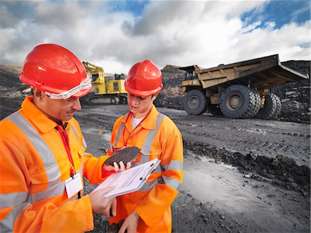 people working coal mines - Workers In Mine Inspecting Coal Stock Photo - Premium Royalty-Free, Code: 649-03294030