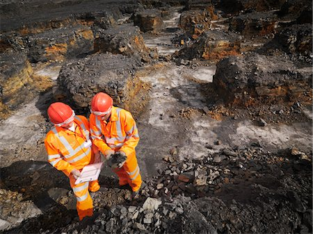 people working coal mines - Workers Inspecting Coal In Mine Stock Photo - Premium Royalty-Free, Code: 649-03294041