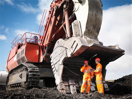 people working coal mines - Workers With Digger In Coal Mine Stock Photo - Premium Royalty-Free, Code: 649-03294043