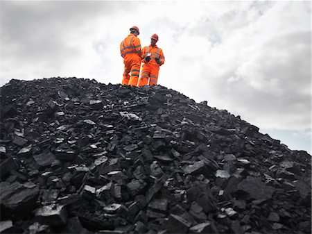people working coal mines - Coal Miners On Pile Of Coal Stock Photo - Premium Royalty-Free, Code: 649-03294055