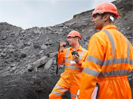 people working coal mines - Coal Miners With Walkie Talkie Stock Photo - Premium Royalty-Free, Code: 649-03294077