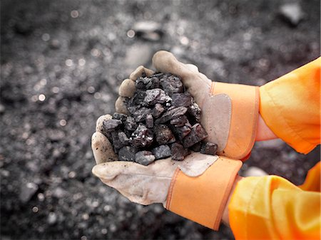 people working coal mines - Coal Worker With Handful Of Coal Stock Photo - Premium Royalty-Free, Code: 649-03294071