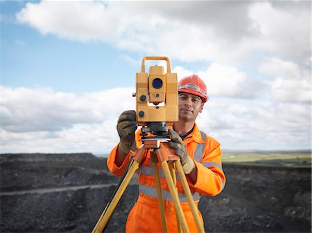 people working coal mines - Coal Miner With Surveying Equipment Stock Photo - Premium Royalty-Free, Code: 649-03294085