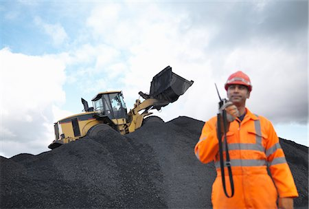 people working coal mines - Coal Miner With Digger On Pile Of Coal Stock Photo - Premium Royalty-Free, Code: 649-03294091