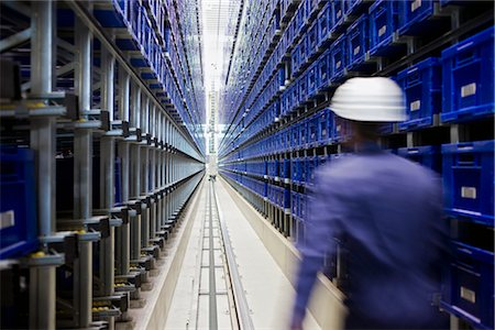 workman in storage Stock Photo - Premium Royalty-Free, Code: 649-03294333