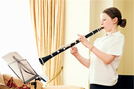 A young girl playing the clarinet Stock Photo - Premium Royalty-Free, Code: 649-03294679