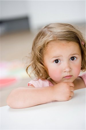 sad girls - young girl frowning at viewer Stock Photo - Premium Royalty-Free, Code: 649-03295966