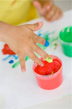 finger painting - young girl playing with colours Stock Photo - Premium Royalty-Free, Code: 649-03295977