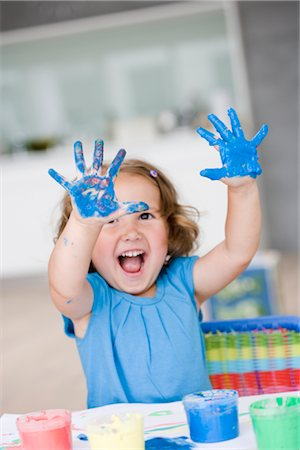 finger painting - young girl playing with colours Stock Photo - Premium Royalty-Free, Code: 649-03295970